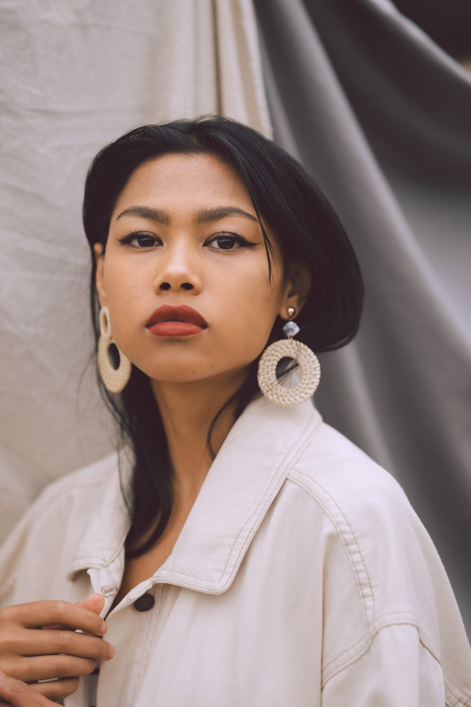 Stylish asian woman in light room