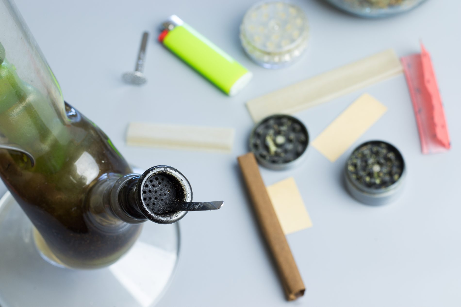 Flat lay of smoking weed accessories. THC use in healthcare.