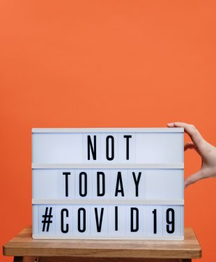 Not today covid19 sign on wooden stool