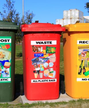 Three brightly colored waste bins placed where they can easily be found and used .