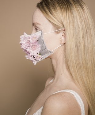 Woman in flower facial mask