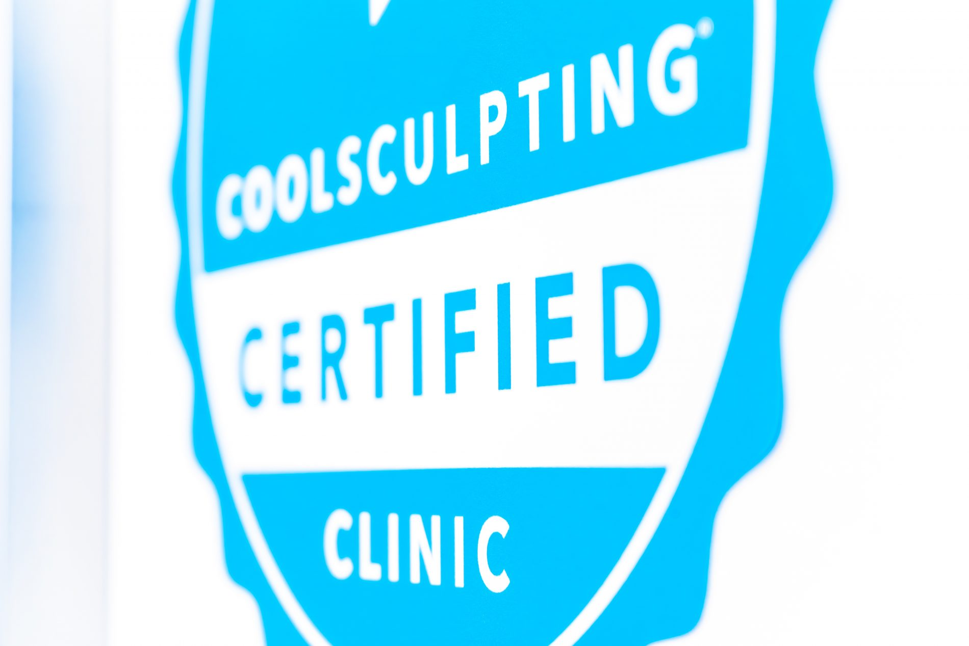 Coolsculpting certified badge decal displayed at a beauty laser clinic offering cryolipolysis cosmetic fat removal.