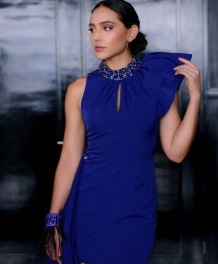 woman in blue sleeveless dress