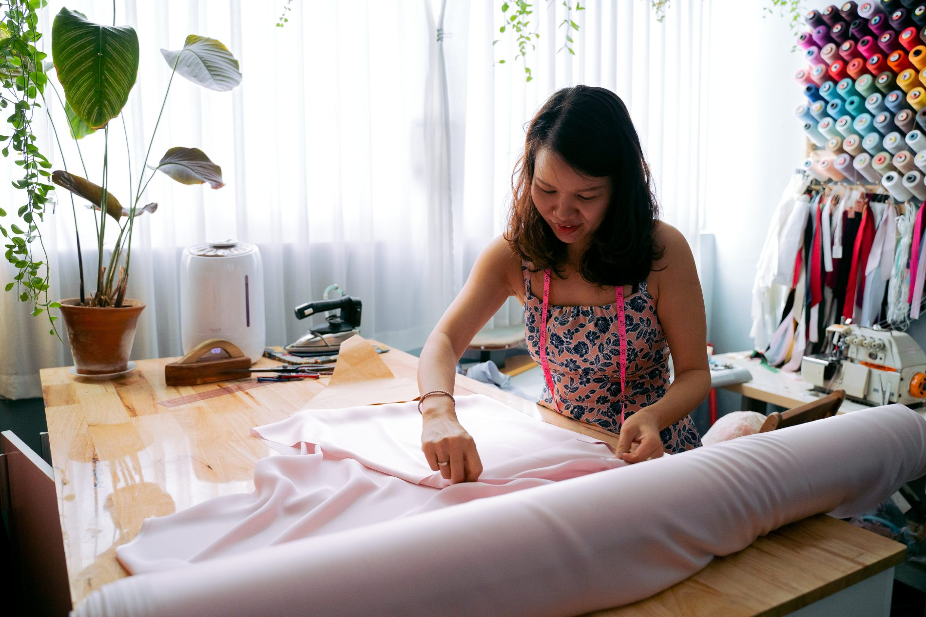 A woman holding a fabric